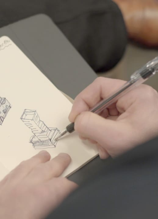 artist sketching a building